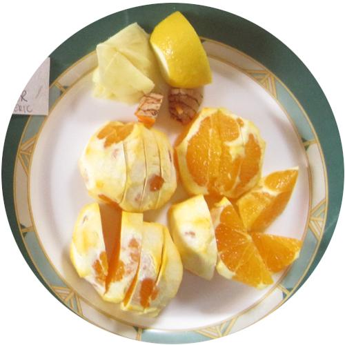 Juicing ingredients sliced for orange lemon ginger turmeric