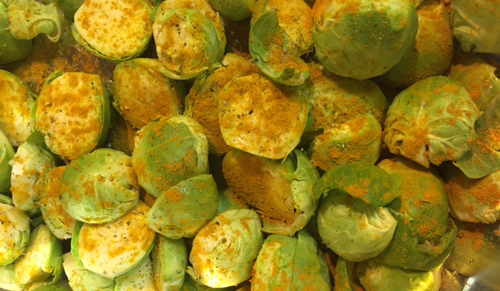 turmeric and other spices over roasted brussel sprouts